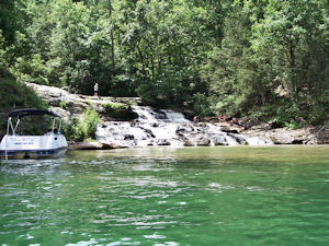 Families enjoying a waterfall on Lake Keowee.